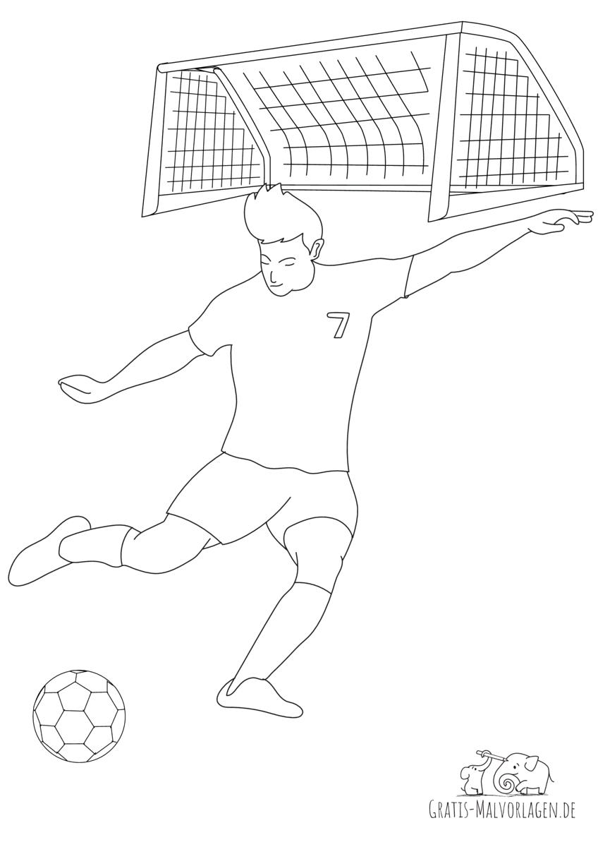 Fußballer vor Tor schießt Ball